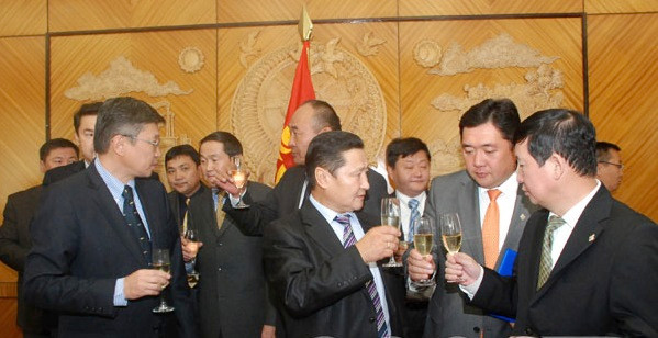 "Altankhuyag Norov, the first Prime Minister to admit that the MANAN exists, drinking champagne with ""possible"" MANAN leaders"